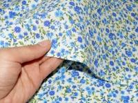 Хлопковая ткань: 218Б. Мелкие голубые розы на кремовой бязи.